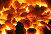 Glowing coals background texture — Stock Photo