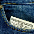 Blue jeans pocket with $100 banknotes — Stock Photo