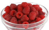 Ripe raspberries in a glass bowl — Stock Photo