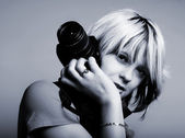Young beautiful woman taking a photo wit — Stock Photo
