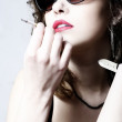 The beautiful girl smokes a cigarette - Stock Photo