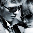 Young couple wearing sunglasses — Stock Photo #2383094