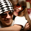 Stock Photo: Fashionable young couple wearing sunglas