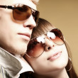 Fashionable young couple wearing sunglas - Photo