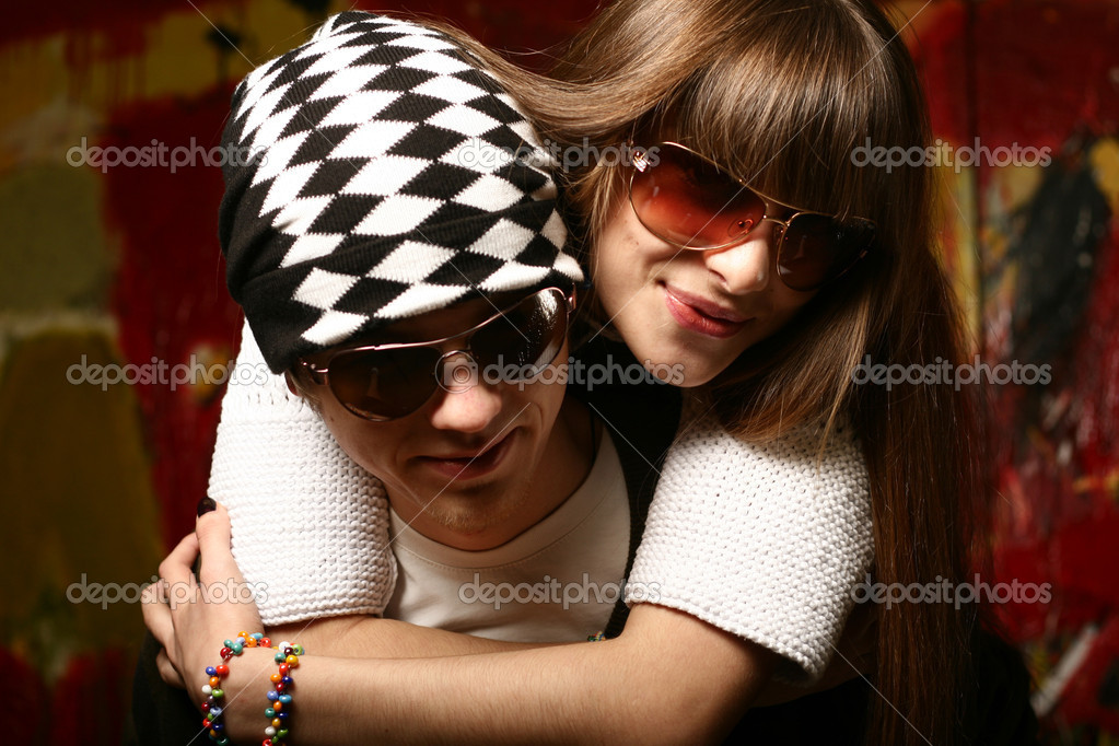 Fashionable young couple wearing sunglasses   Stock Photo #2663912