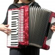 Stock Photo: Cutout with womplaying accordion on