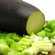 Eggplant and cutted  spring onion on woo — Stock Photo