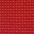 Background textile holey in red — Stock Photo