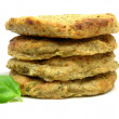 Potato dough cakes with basil lying upon — Stock Photo