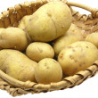 a basket with potatoes on a white backgr — Stock Photo