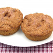 Royalty-Free Stock Photo: Two raspberry muffins on a white plate o