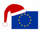 Flag of Europe with Santa Claus cap — Stock Photo