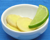 Ginger with lemon in a bowl of chinaware — Stock Photo