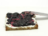 Wholemeal butterbread with bilberry jam — Stock Photo