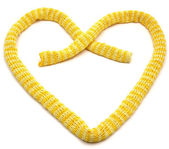 Yellow striped knitting scarf arranged a — Stock Photo