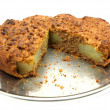 Sliced wholemeal  pear cake on a cake pl - Stock Photo