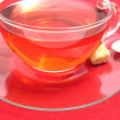 Tea cup with rose hip tea on a placemat — Stock Photo