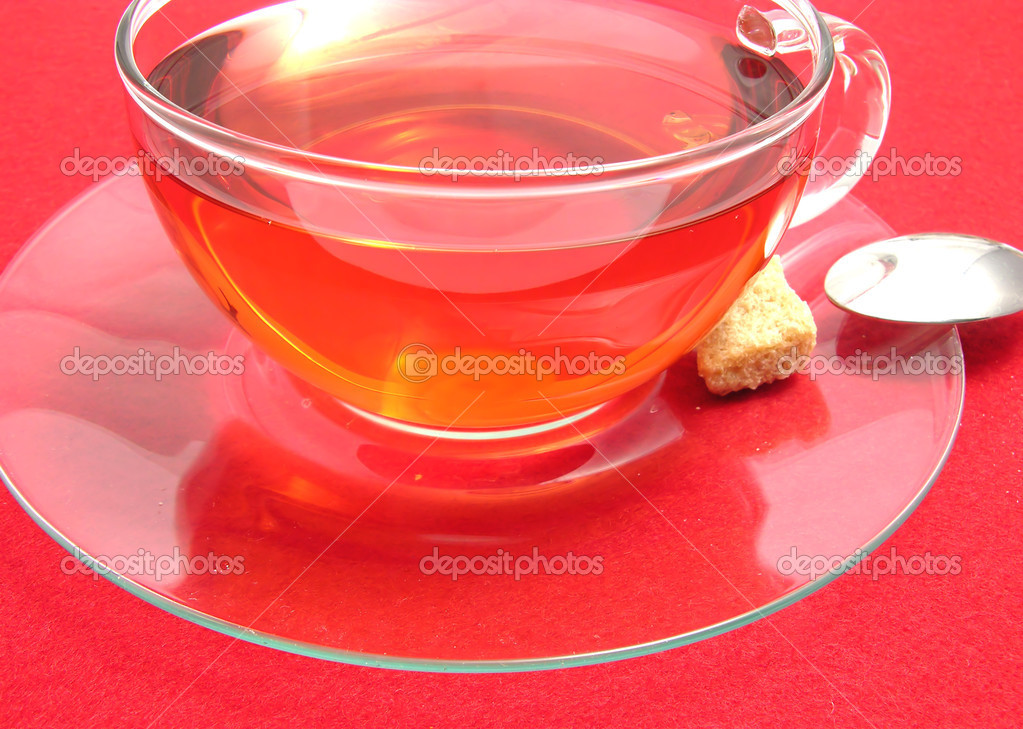 Tea cup with rose hip tea on a placemat — Stock Photo #1314994