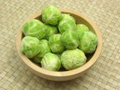 Wooden bowl with brussels sprouts — Stock Photo