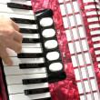 Hand playing accordion - Stock Photo