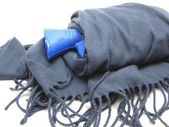 Blue hot-water bag wrapped in scarf — Stock Photo