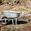 Cutout with a hand barrow on a site — Lizenzfreies Foto
