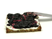 Butterbread with bilberry jam — Stock Photo