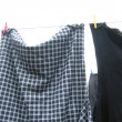 Clothesline  with some laundered clothes — 图库照片