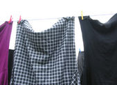 Clothesline with some laundered clothes — Stock Photo