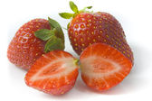 Two ripe strawberries and two segments — Stock Photo