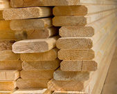 Sawed wooden boards laid in a heap. — Stock Photo
