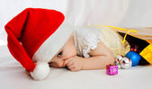Child in christmas hat — Stockfoto