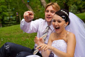 Newlywed with soap bubbles — Stockfoto