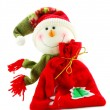 Christmas snowman with sack of gifts - Stock Photo