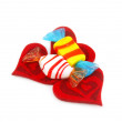 Three red hearts made of cloth and sweet - Stock Photo