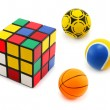 Three colored balls and cube - Stock Photo