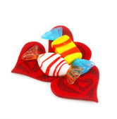 Three red hearts made of cloth and sweet — Stock Photo