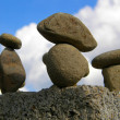 Figure from stones on a sky background — Stock Photo