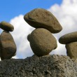Figure from stones on a sky background - Stock Photo