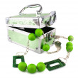 Stock Photo: Light green trunk, beads and armlet isol