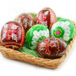 Foto Stock: Group of painted Easter eggs in wooden b