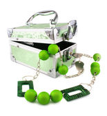 Light green trunk, beads and armlet isol — Stock Photo