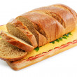 Whole wheat bread on the table wooden bo — Stock Photo #1317084