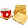 Colored cup and set of wooden trivets — Stock Photo