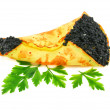 Caviar-stuffed pancake with greens - Stock Photo