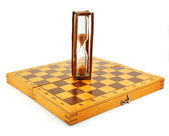Chessboard and hourglass — Stock Photo