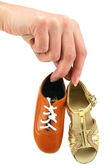 Female hand holds tiny dancing shoes — Stock Photo