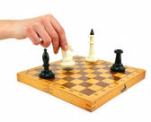Chessboard and female hand gives check — Stock Photo