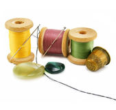 Spool of thread, thimble and needle — Stock Photo