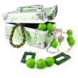 Light green trunk, beeads and armlet isolated — Stock Photo